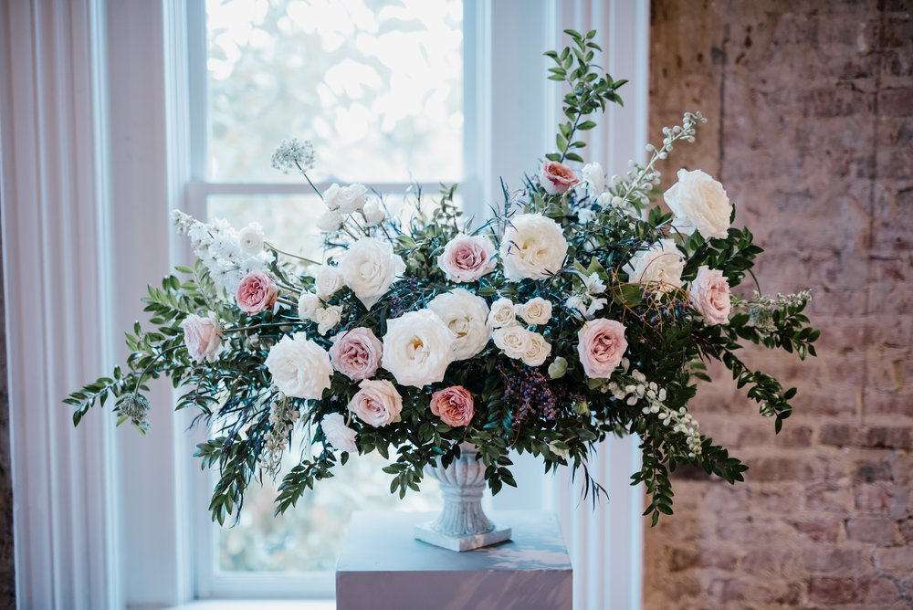 Muted, organic flowers using white garden roses, ranunculus, and lush greenery // Southeastern Wedding Floral Design