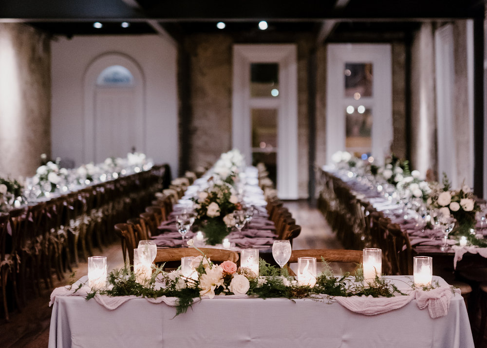 Sweetheart table with asymmetrical floral garland // Nashville Wedding Flowers