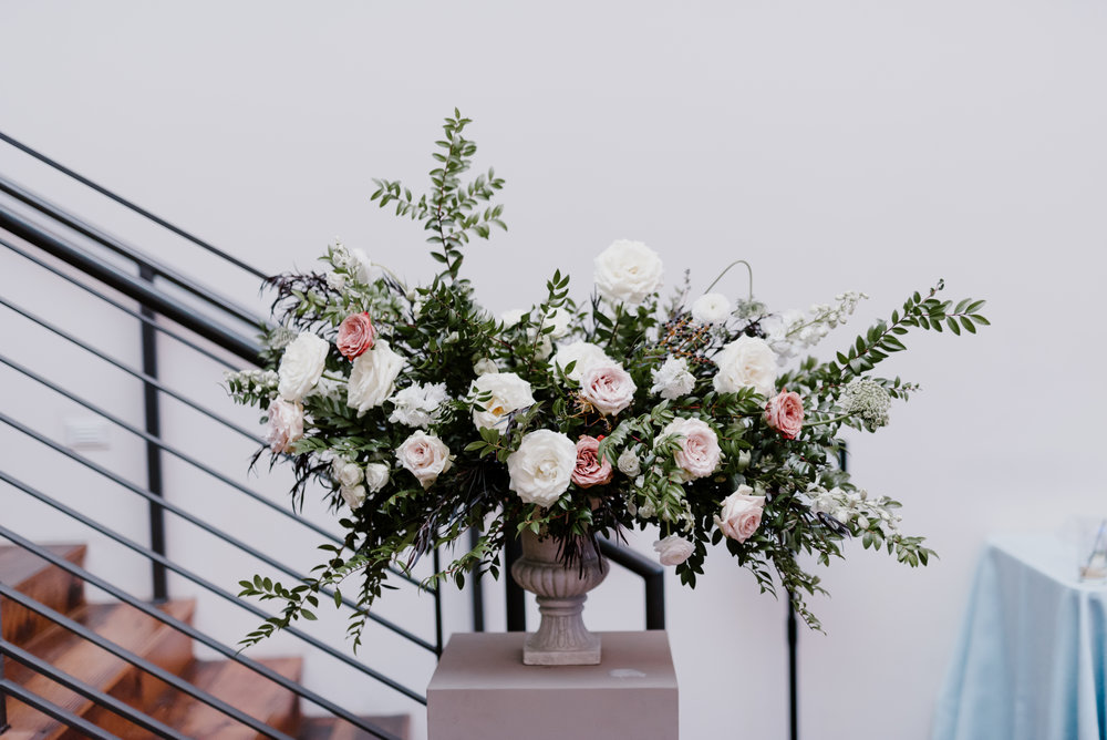 Statement floral arrangement with white flowers, hints of blush and neutrals, and organic greenery // Nashville Floral Designer