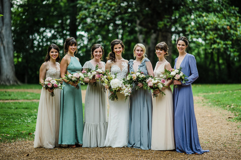 Soft blues and greens mix and match bridesmaid dresses // Garden party wedding with neutral, muted flowers with airy, whimsical greenery and texture // Southeastern Wedding Florist