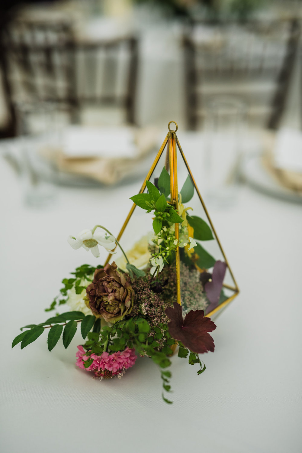 Gold geometric terrarium with muted florals and greenery spilling out // Nashville Wedding Floral Design