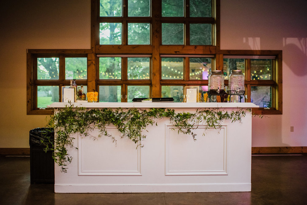 Organic greenery adorning the bar // Nashville Wedding Floral Design