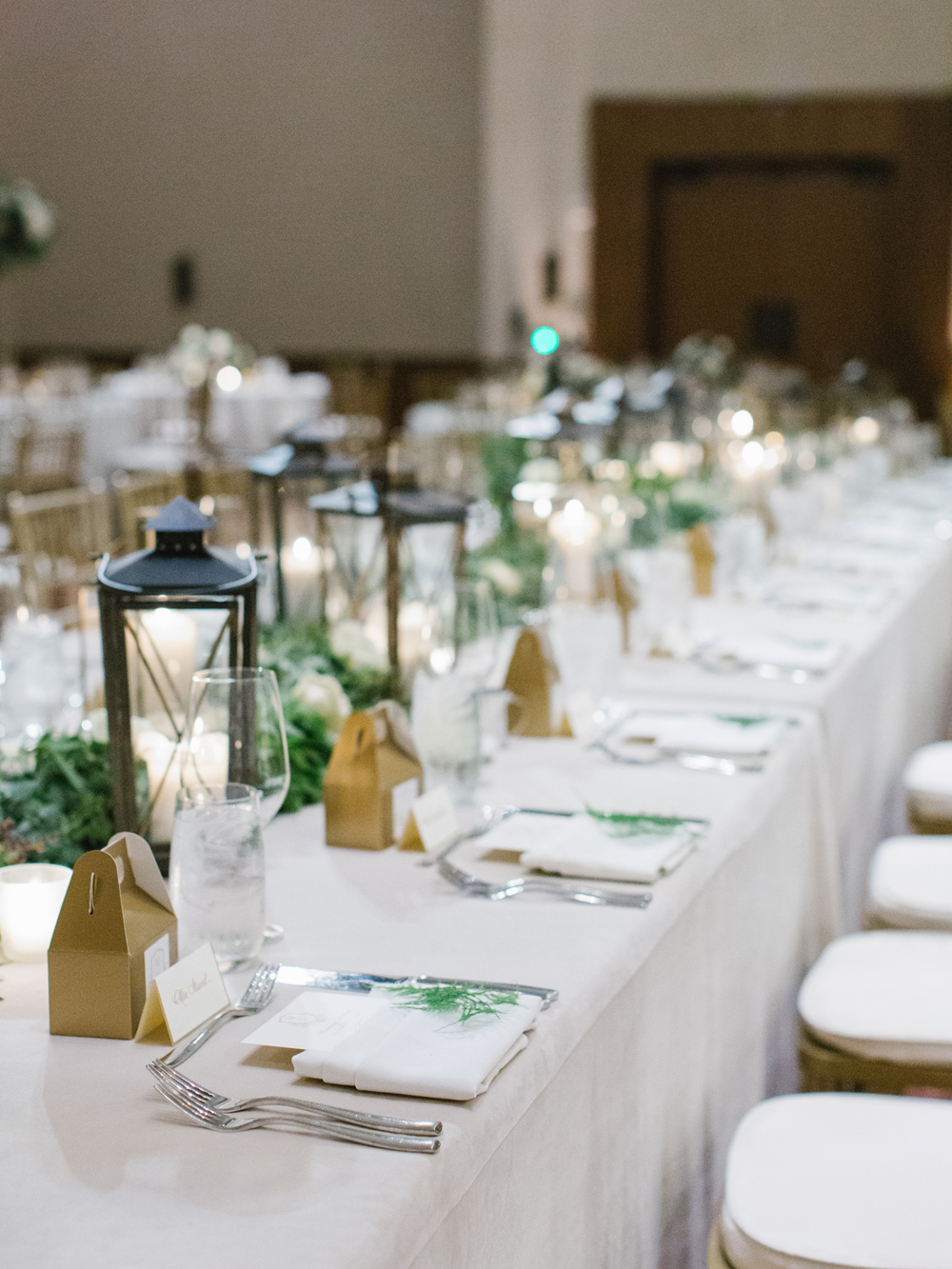 Head Table with lanterns and greenery garland // Nashville wedding floral design
