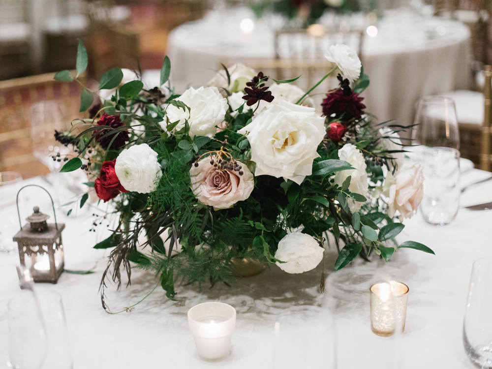 Low gold vessel overflowing with lush arrangement of garden roses and dahlias // Nashville Wedding Floral Design