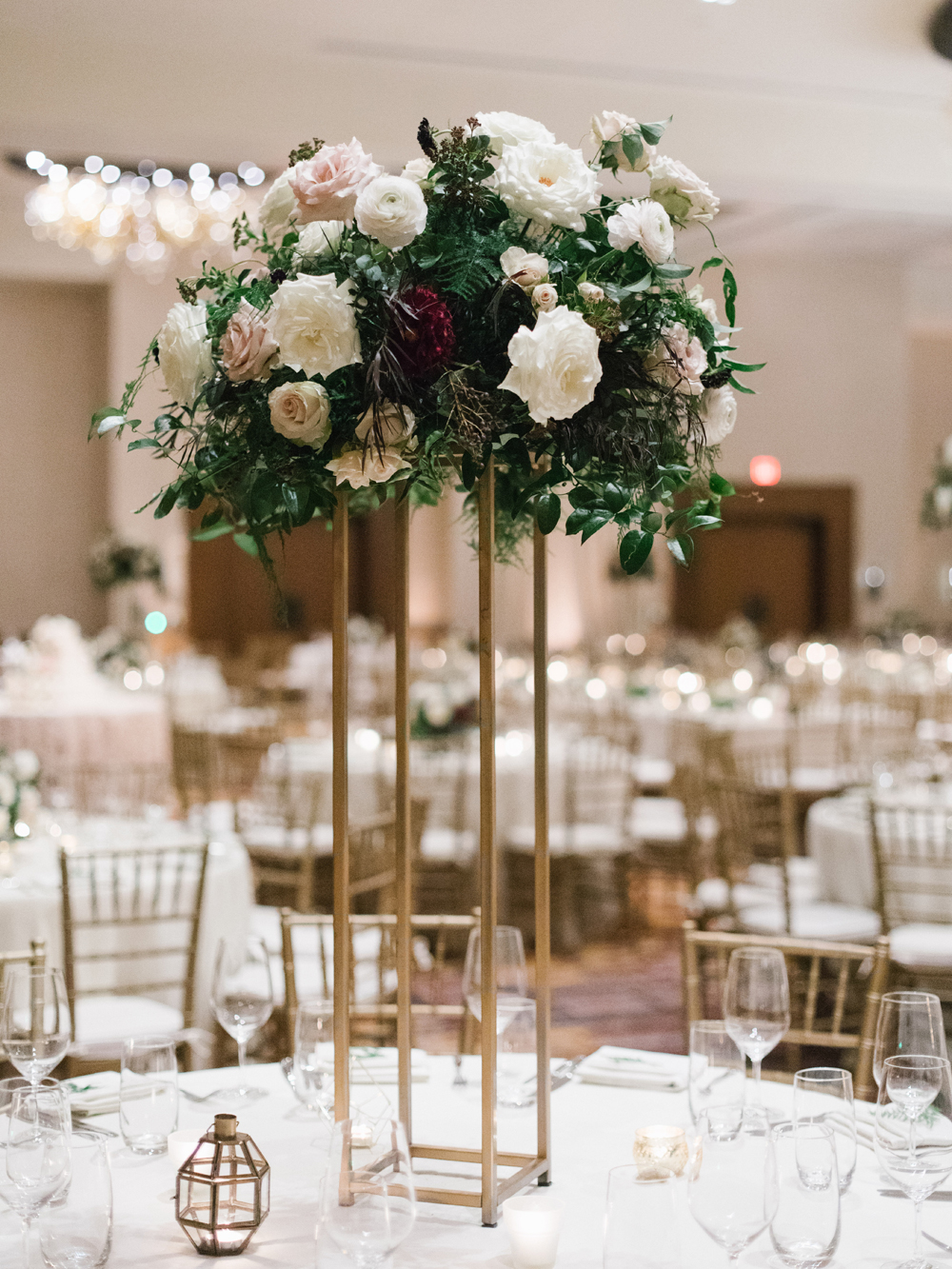 Elevated floral centerpiece with lush greenery, garden roses, and dahlias // Southeastern Wedding Florist