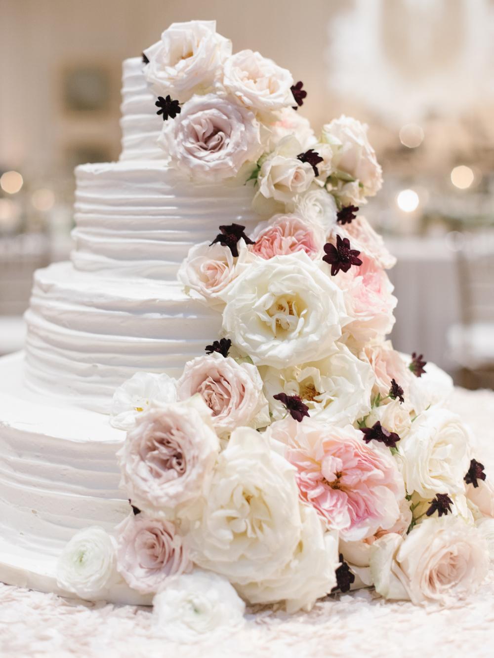 Lush cake flower cascade // Nashville Wedding Florist