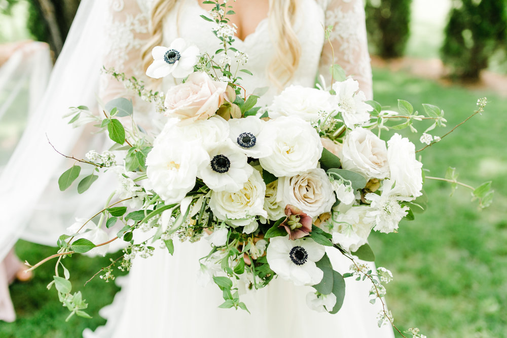 Lush, all-white bridal bouquet with anemones and garden roses // Nashville Wedding Floral Design