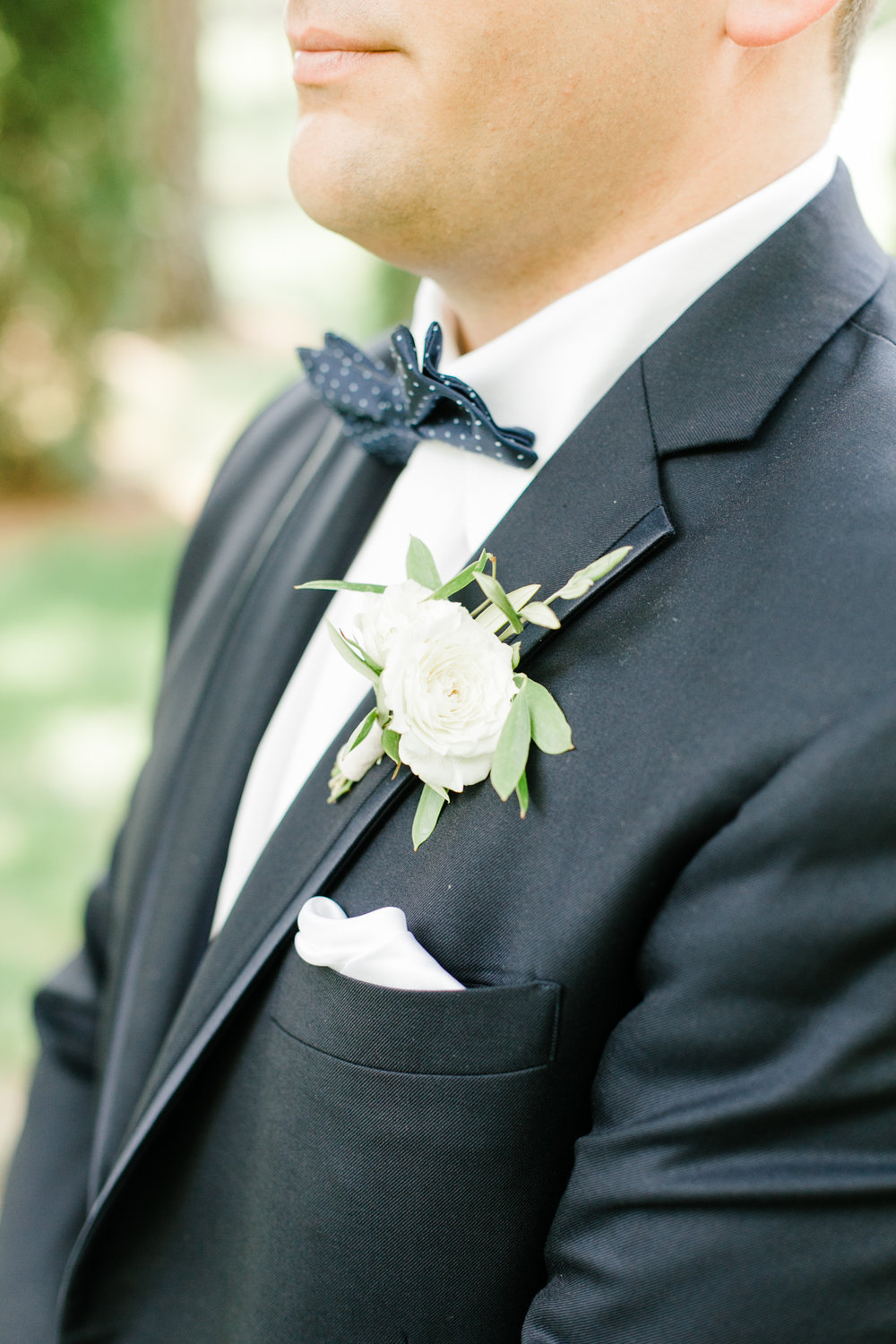 Simple white and greenery boutonniere // Nashville Wedding Flowers