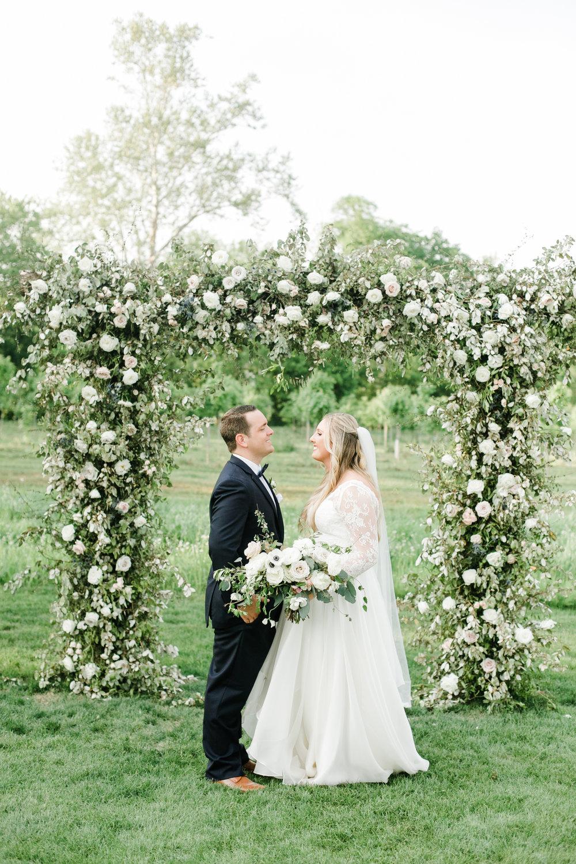 Natural, organic floral arch for the wedding ceremony backdrop // Nashville Wedding Floral Design