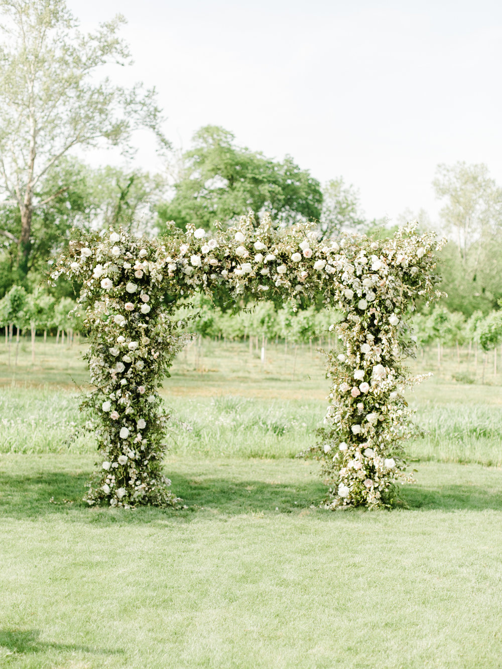 Large wedding arch with lush greenery and white and blush florals // Nashville Wedding Florist