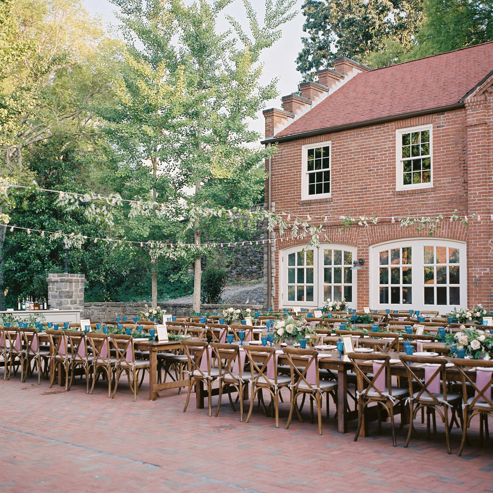 Cheekwood Courtyard Wedding with string lights with vine-like greenery // Nashville Wedding Floral Designer