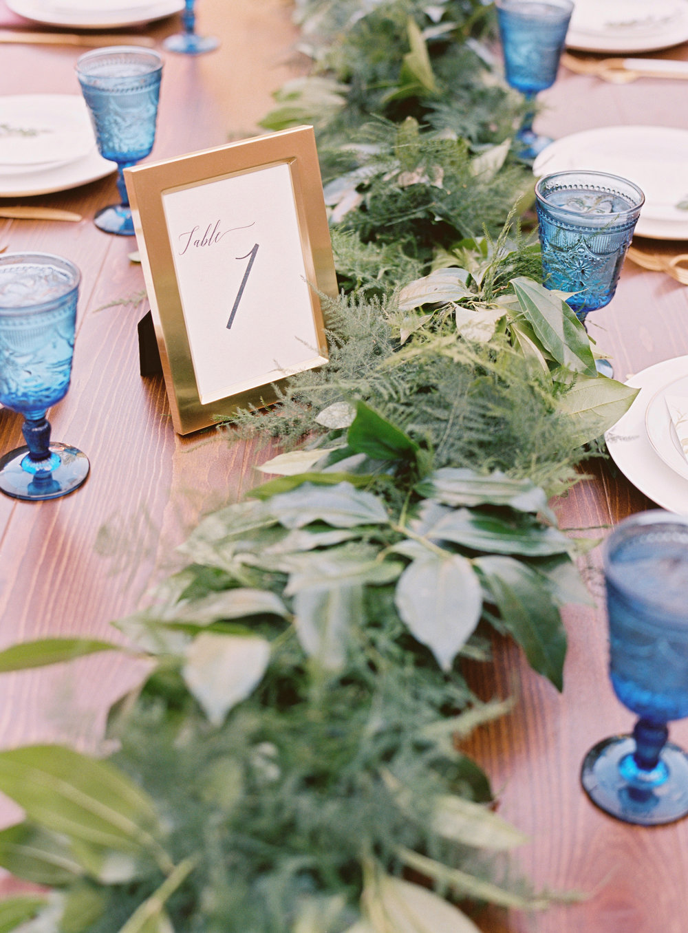 Lush greenery runners on farm tables // Nashville Wedding Floral Design