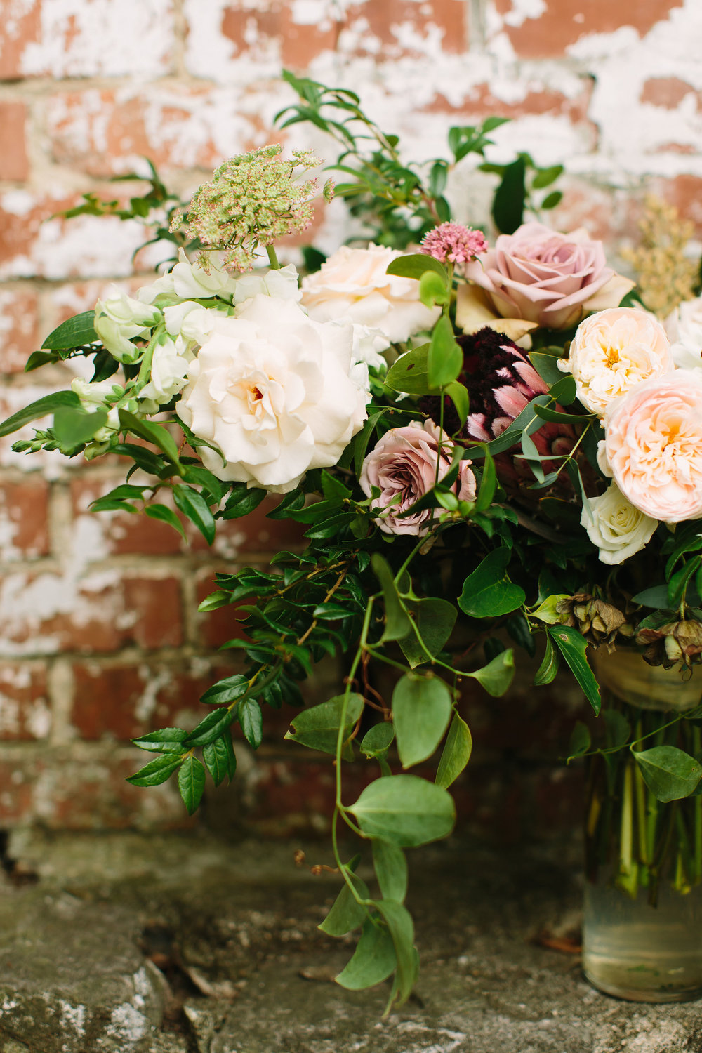 Lush bridal bouquet with garden roses and ranunculus in hues of cream and dusty mauve // Nashville Wedding Floral Design