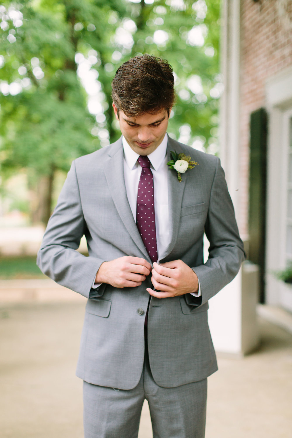 Simple white ranunculus groom's boutonniere // Southeastern US Wedding Floral Design