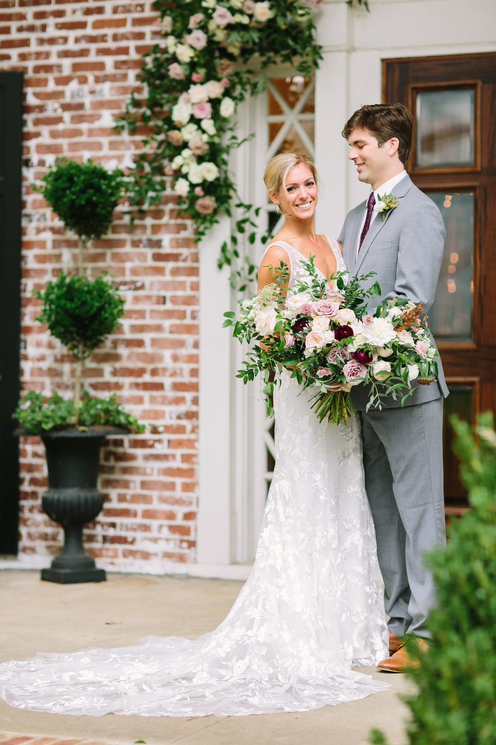 Lush, untamed bridal bouquet in shades of dusty mauve, ivory, blush, and greenery // Nashville Wedding Florist