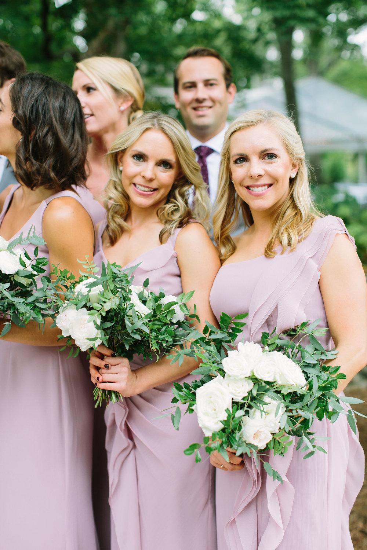 Lush, garden-inspired bridesmaid bouquets with garden roses, ranunculus, and dahlias // Nashville Wedding Florist