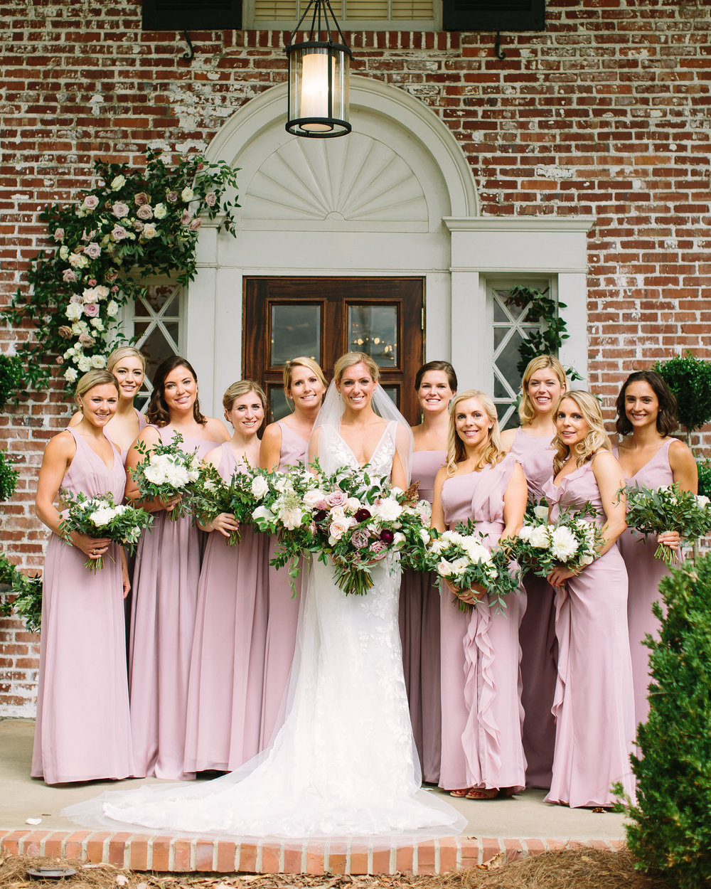 Dusty rose bridesmaid dresses with cream bouquet with lush greenery // Nashville Wedding Floral Design