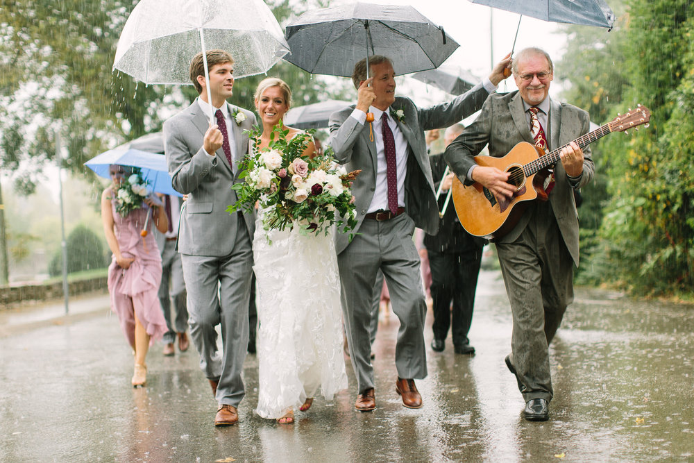 New Orleans style wedding parade in the rain // Nashville Wedding Florist