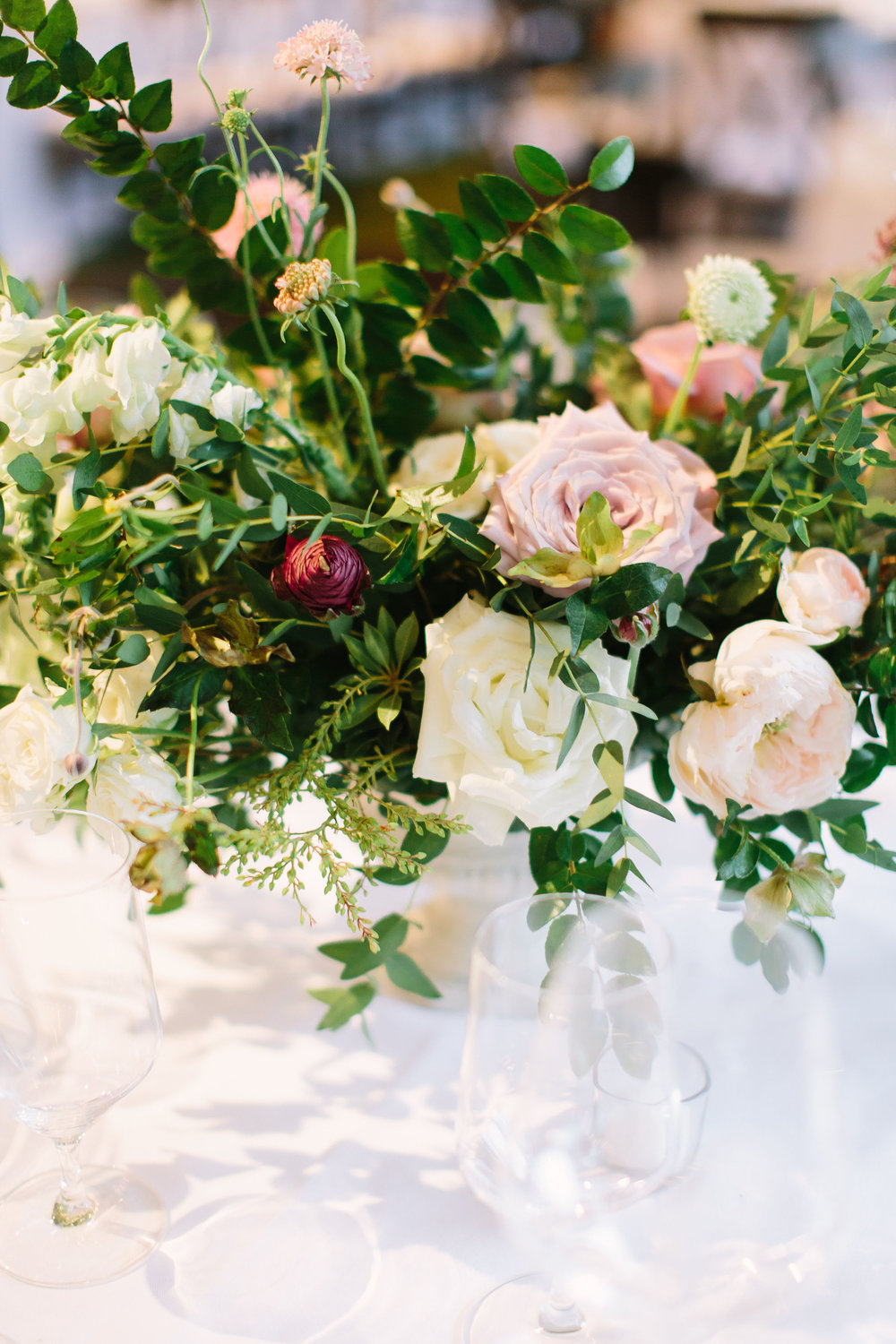 Lush, natural centerpiece of garden roses, ranunculus, and greenery // Nashville Backyard Wedding Flowers