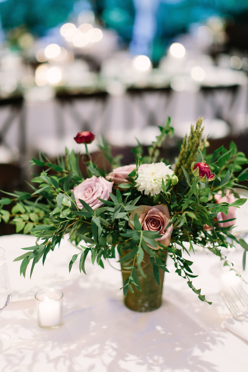 Low patina vessel filled with soft mauve and cream florals and greenery // Nashville Wedding Florist