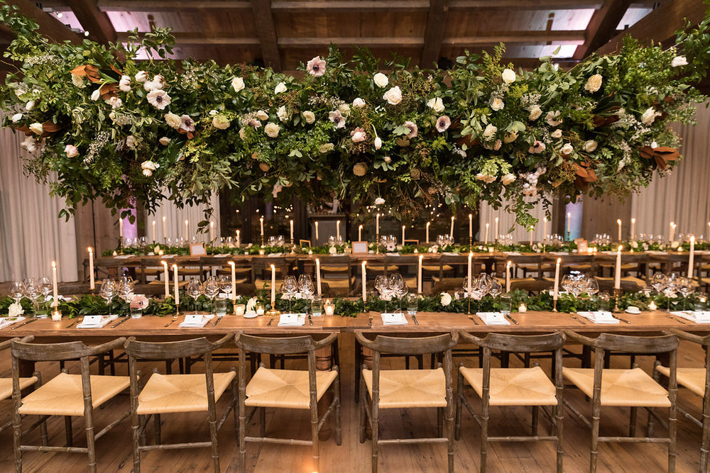 Large hanging floral installation over the head table // Blackberry Farm Wedding Flowers done by Nashville Floral Designer, Rosemary & Finch