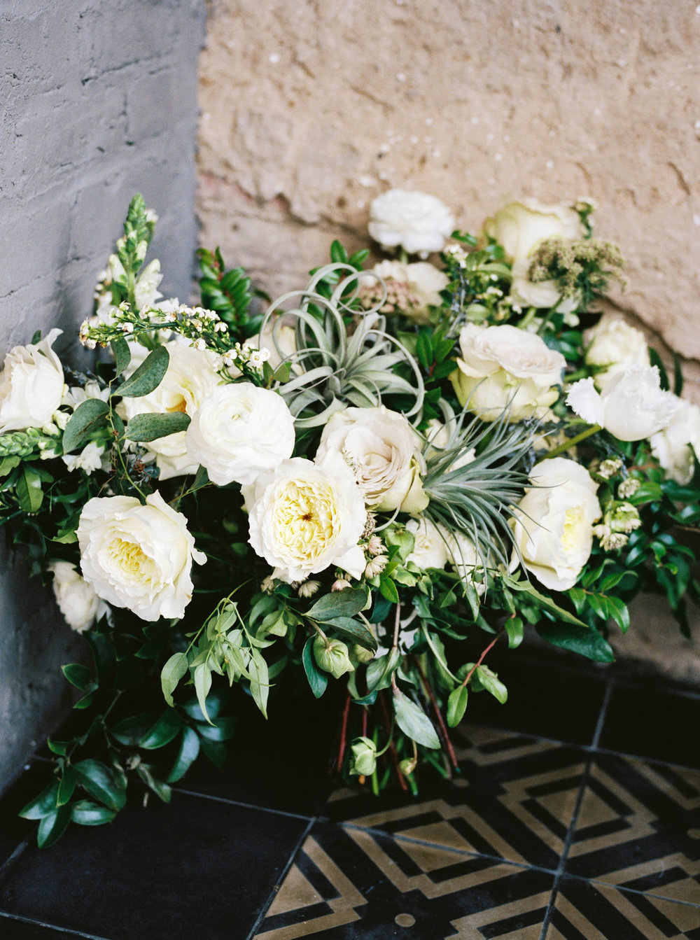 Lush white and cream bridal bouquet with air plants, greenery and texture // Southern Wedding Florist