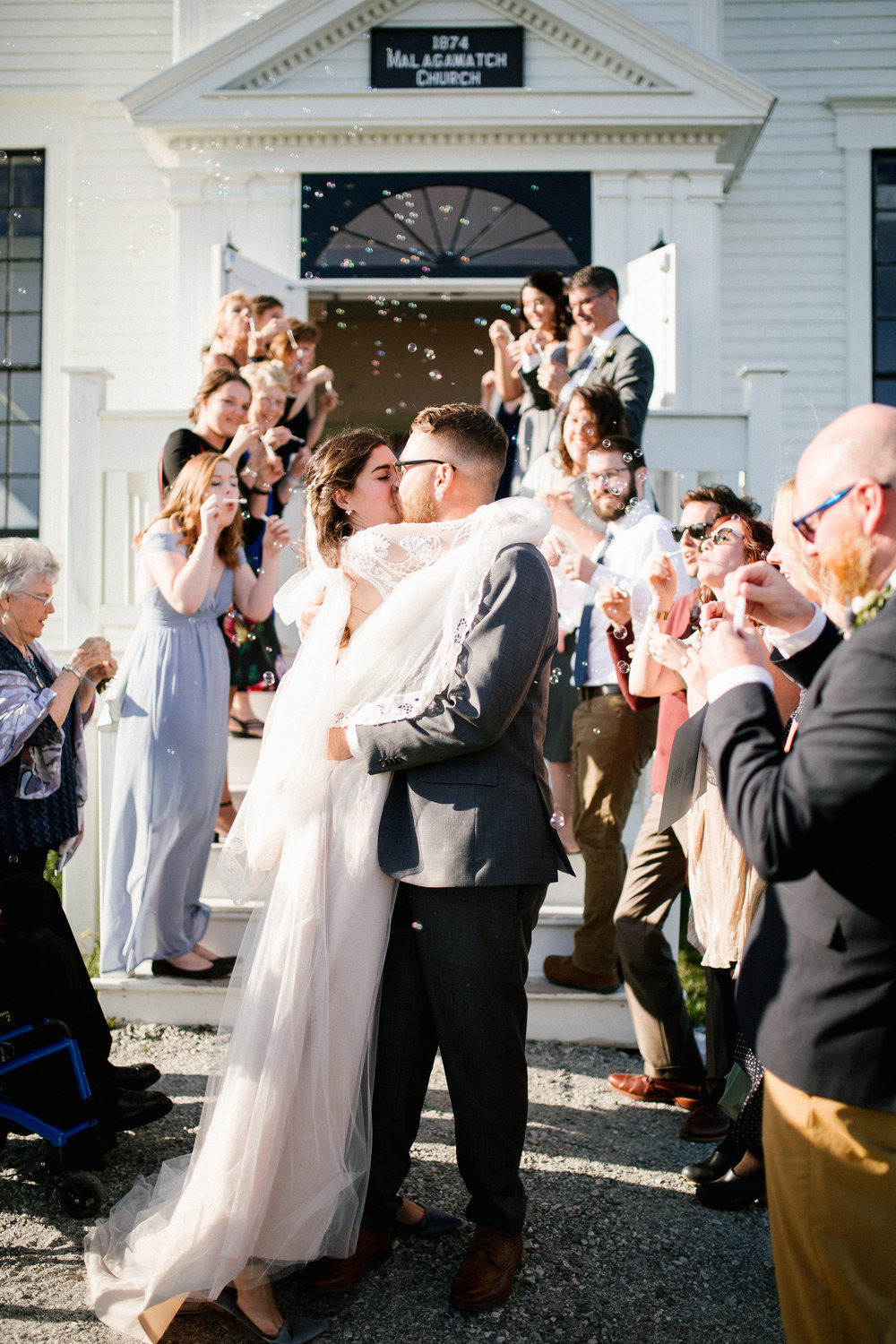 Bubble exit from an intimate wedding ceremony in Nova Scotia