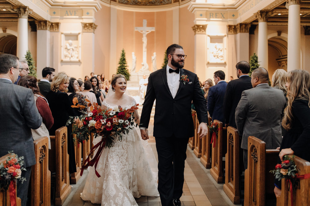 Burgundy velvet bridesmaid dresses with lush, asymmetrical bouquets using garden roses, ranunculus, and anemones. Nashville Wedding Floral Design at the Cathedral.