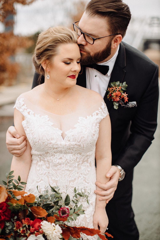 Lush bridal bouquet with autumn foliage, anemones, dahlias, and garden roses. Nashville Wedding Floral Design at the Cordelle.