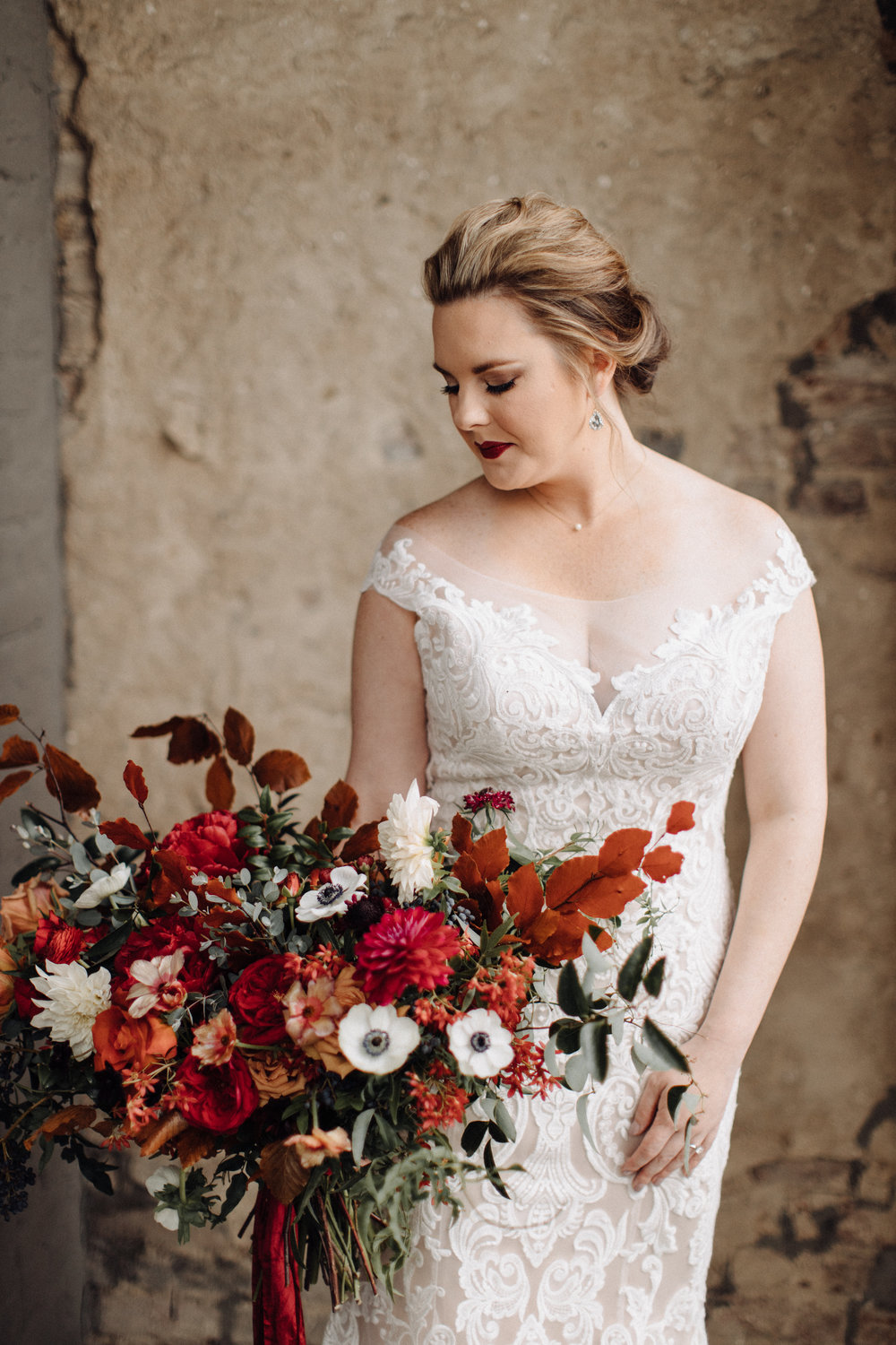 Airy, untamed bride's bouquet of lush greenery, berries and textures, burgundy  peonies, burnt orange garden roses, anemones, and dahlias. Nashville Wedding Floral Design at the Cordelle.