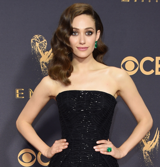 Emmy Rossum added a pop of color to her black strapless sequin Zac Posen gown via 58-carat Colombian emerald drop earrings and a 19-carat emerald cocktail ring from Lorraine Schwartz.