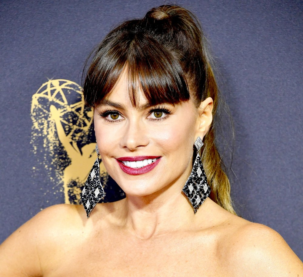 Bombshell Sofia Vergara in oversized diamond and sapphire chandelier earrings by Lorraine Schwartz.