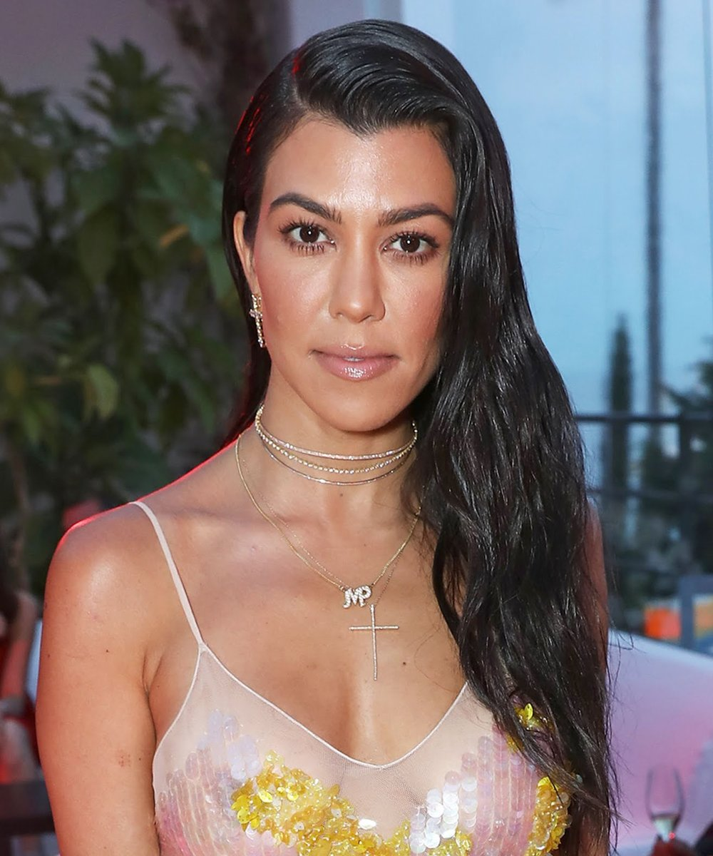 Kourtney K in a Large Diamond Cross Necklace
