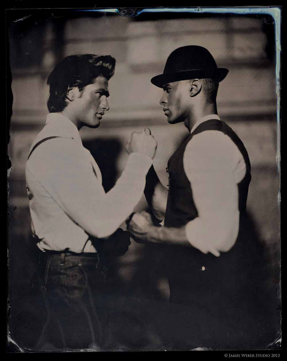 "Model: Baptiste(right), Korey(left)v @ RED NYC. On Baptiste: Trousers and shirt by Craig Robinson NY. On Derek: Shirt, Waistcoat, and Trousers - Craig Robinson NY. Vintage Hat 8""x10"" on Black Aluminum. © James Weber 2013"