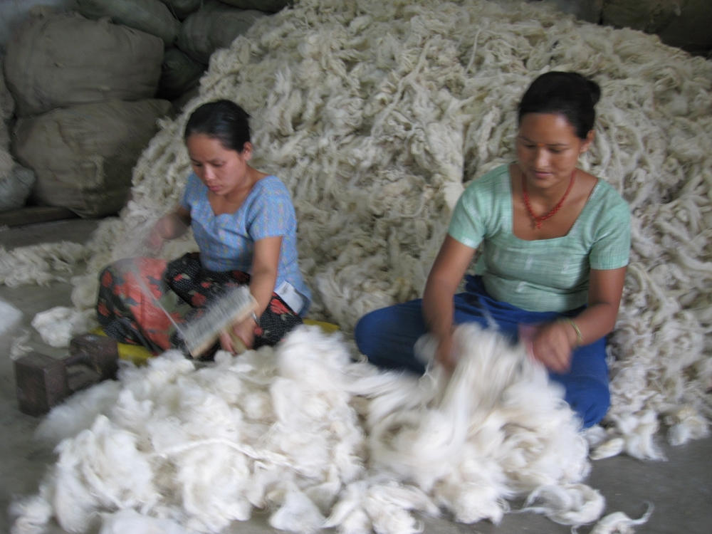 Women sorting wool by hand