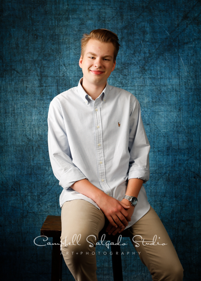 Portrait of high school senior on denim background by teen photographers at Campbell Salgado Studio in Portland, Oregon.