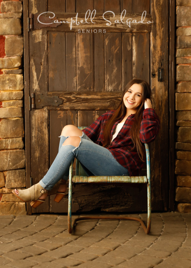 Portrait of female teen on rustic door background by Portland photographers - senior pictures at Campbell Salgado Studio in Portland, Oregon.