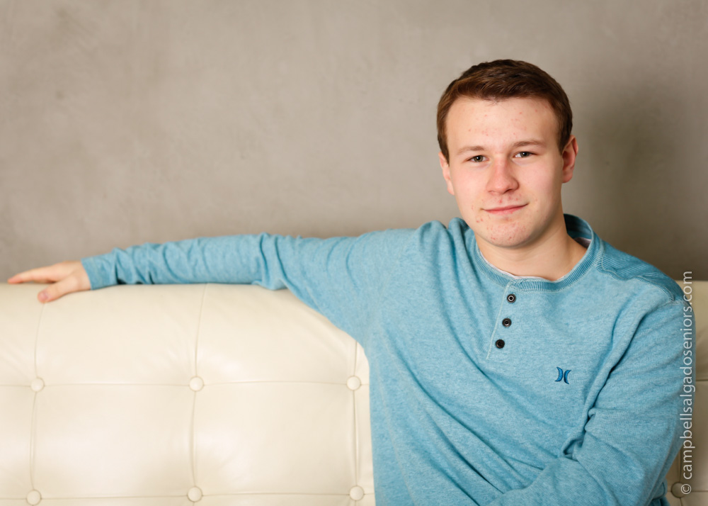 Portrait of HS senior on modern grey background by teen photographers at Campbell Salgado Studio in Portland, Oregon.