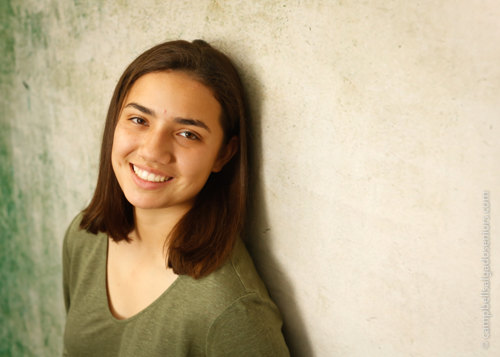 Portland senior pictures, portrait of teen on weathered green background by high school senior photographers at Campbell Salgado Studio in Portland, Oregon.