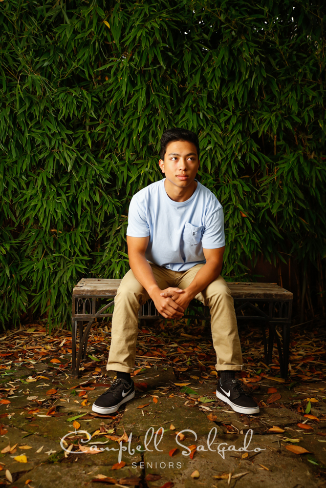 Portland senior pictures, portrait of teen on bamboo background by high school senior photographers at Campbell Salgado Studio in Portland, Oregon.
