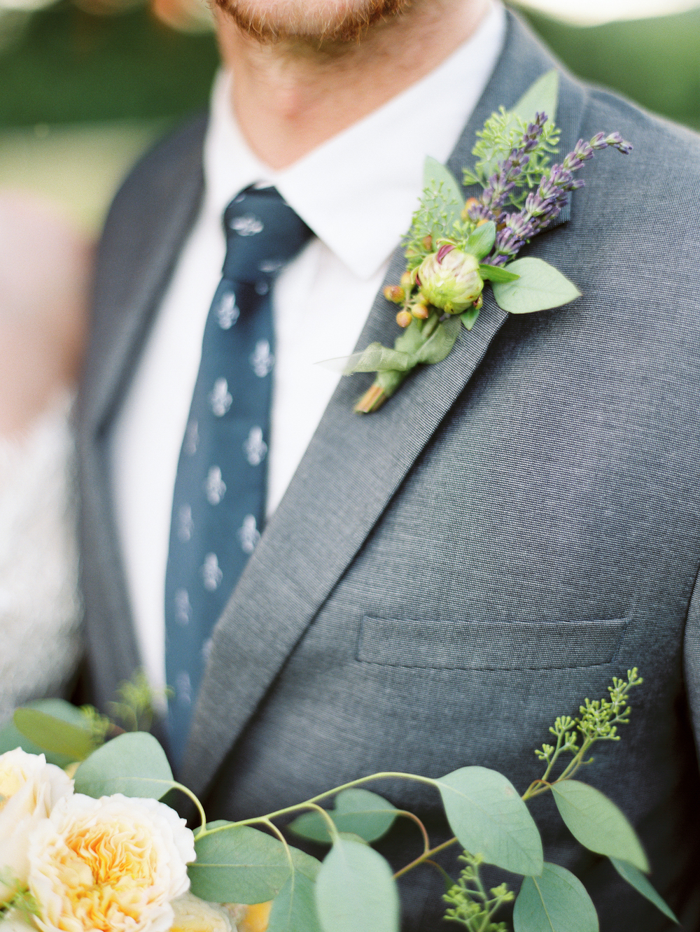 Lavender-boutonniere-grey-suit-wedding-groom