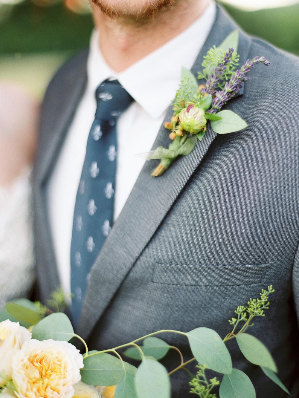 Lavender-boutonniere-grey-suit-wedding-groom