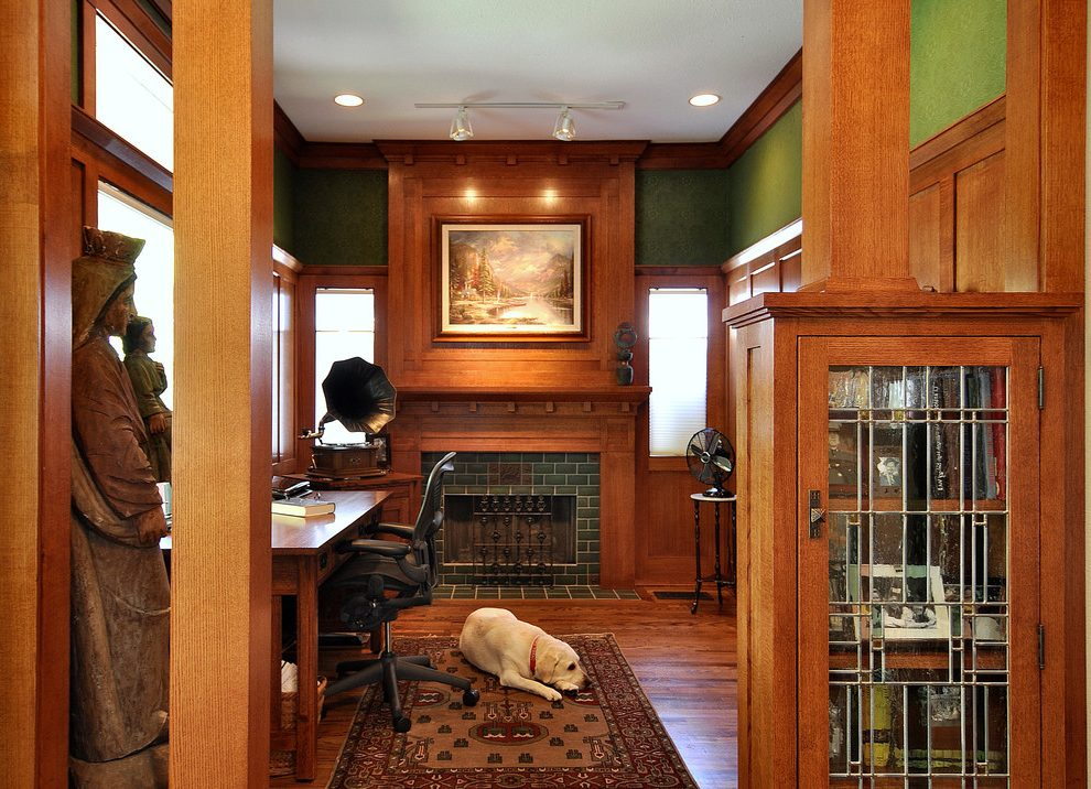 craftsman-style-wainscoting-home-office-with-tile-fireplace-surround-wooden-clipboards.jpg