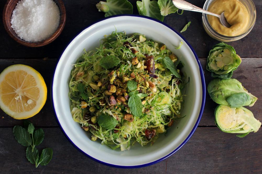 Lemony brussel sprout slaw w/ dates, pistachios & mint