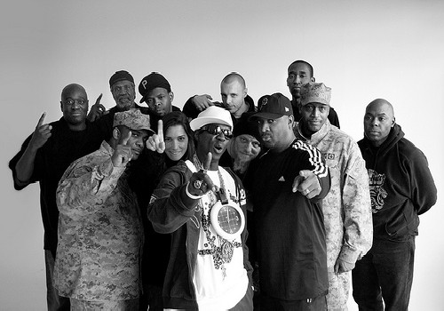 Public Enemy clarify the time on Flavor Flav's novelty clock.  Public Enemy Number 1  by Thomas Ricker/ cc