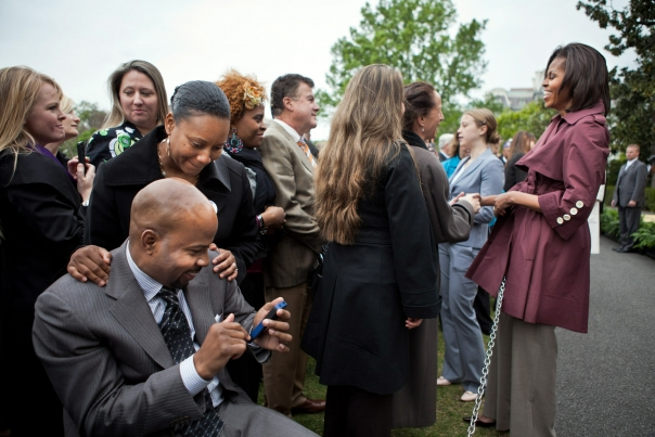 Rebuild Hope founder Dana Hendrickson awaits his opportunity to talk to our First Lady   Joining Forces Anniversary Celebration - White House South Lawn - April 11, 2012