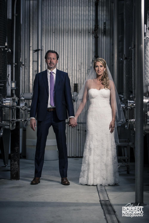 macari-vineyards-wedding-robert-roscigno-photography-bride-groom-wine-barrels
