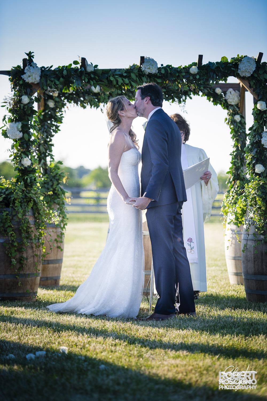 macari-vineyard-new-york-wedding-photographer-robert-roscigno-first-kiss