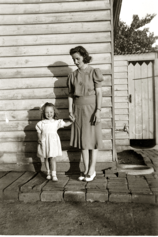 My mother and I in Moama, 1947. I look like Shirley Temple!