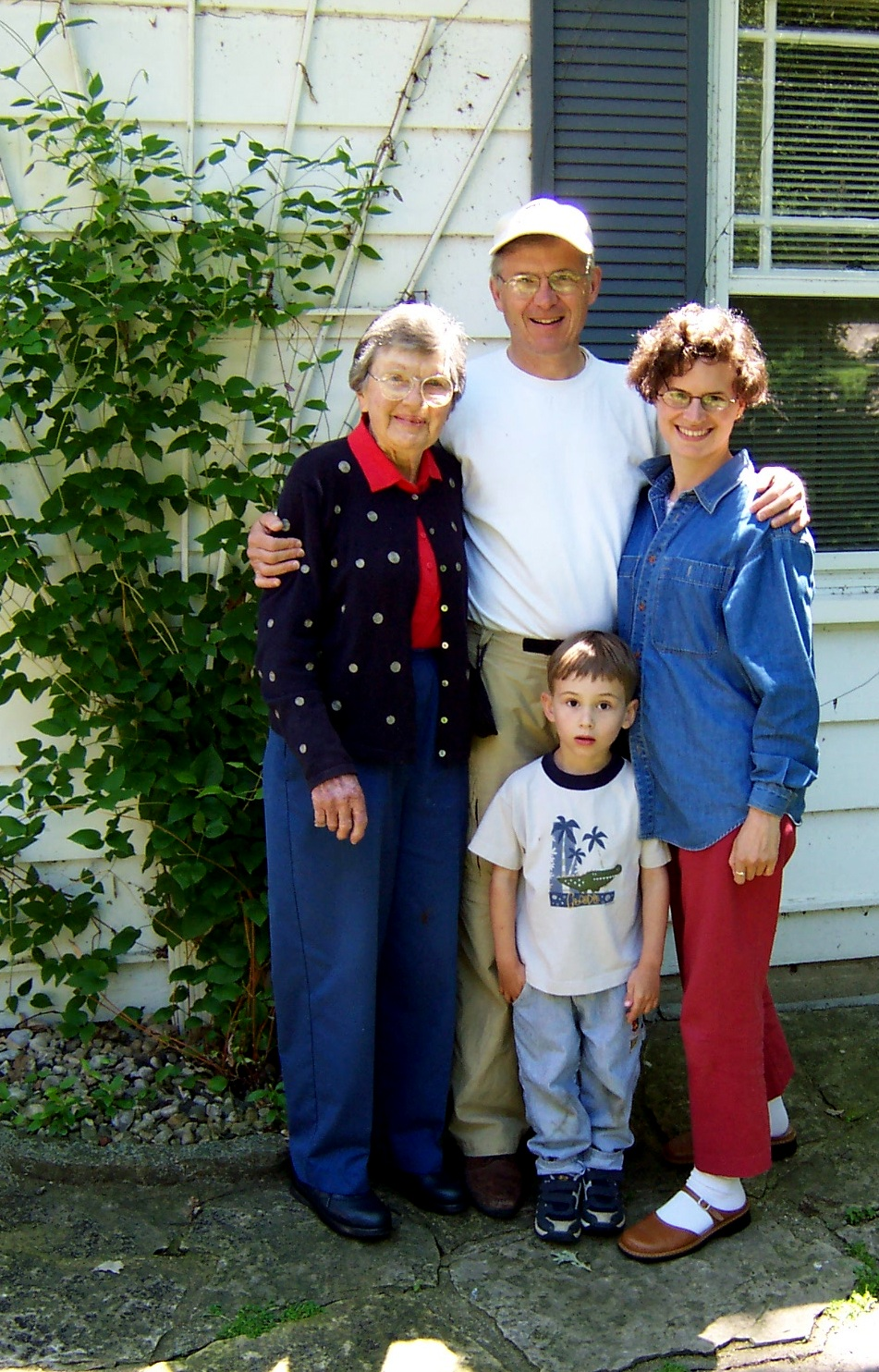 Four generations by the well-tended clematis, summer 2004.